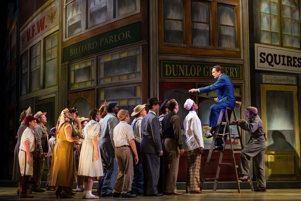 Dwayne Croft as Harold Hill with members of the ensemble in The Glimmerglass Festival's production of  The Music Man .