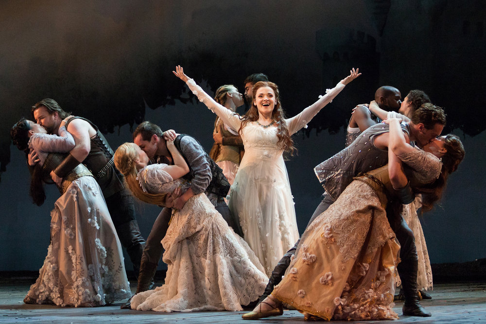 Andriana Chuchman as Guenevere (center) with members of the chorus in The Glimmerglass Festival production of  Camelot .