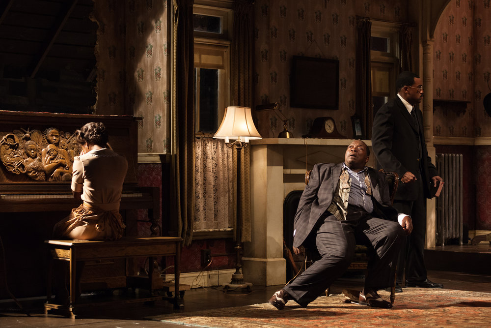 The Signature Theatre production (2012) of August Wilson's  The Piano Lesson . Chuck Cooper, center, Eric Lenox Abrams and Roslyn Ruff, at the piano. Photographed for The New York Times.