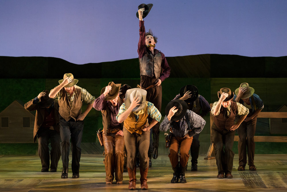 Tucker Reed Breder as Mike (center) and members of the company in The Glimmerglass Festival's 2017 production of Rodgers and Hammerstein's  Oklahoma!