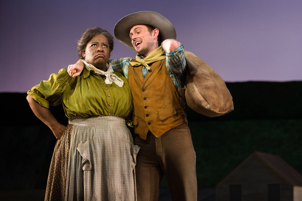 Judith Skinner as Aunt Eller and Michael Roach as Will Parker in The Glimmerglass Festival's 2017 production of Rodgers and Hammerstein's  Oklahoma!