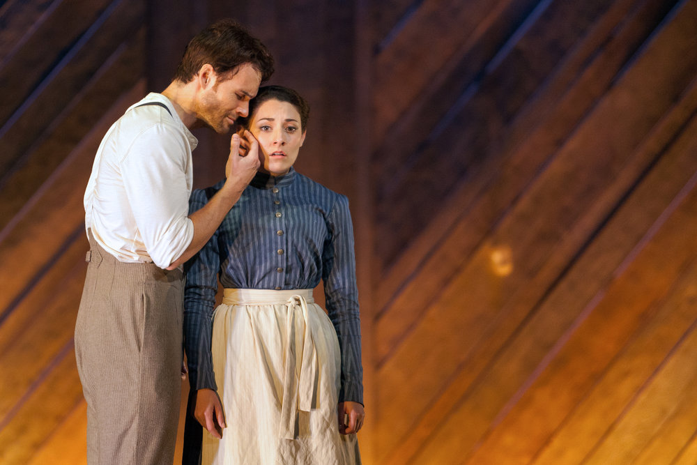 Ryan McKinny as Billy Bigelow and Andrea Carroll as Julie Jordan in The Glimmerglass Festival's 2014 production of Rodgers and Hammerstein's  Carousel .