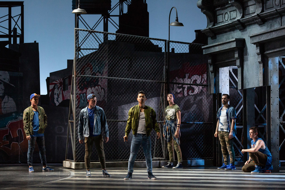 L to R: Spencer Britten as Gee-Tar, PJ Palmer as Action, Brian Vu as Riff, Tucker Reed Breder as Big Deal, Andrew Ryan as A-Rab and Tyler Whitaker as Baby John in The Glimmerglass Festival's 2018 production of Bernstein's  West Side Story .