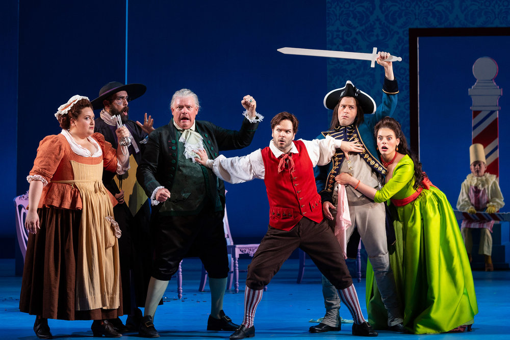 L to R: Alexandria Shiner as Berta, Timothy Bruno as Don Basilio, Dale Travis as Doctor Bartolo, Joshua Hopkins as Figaro, David Walton as Count Almaviva and Emily D'Angelo as Rosina in The Glimmerglass Festival's 2018 production of Rossini's  The Barber of Seville .