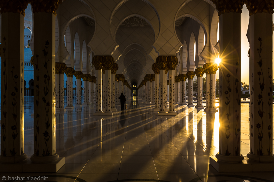 A scene from the Sheikh Zayed Grand Mosque in Abu Dhabi during sunset.