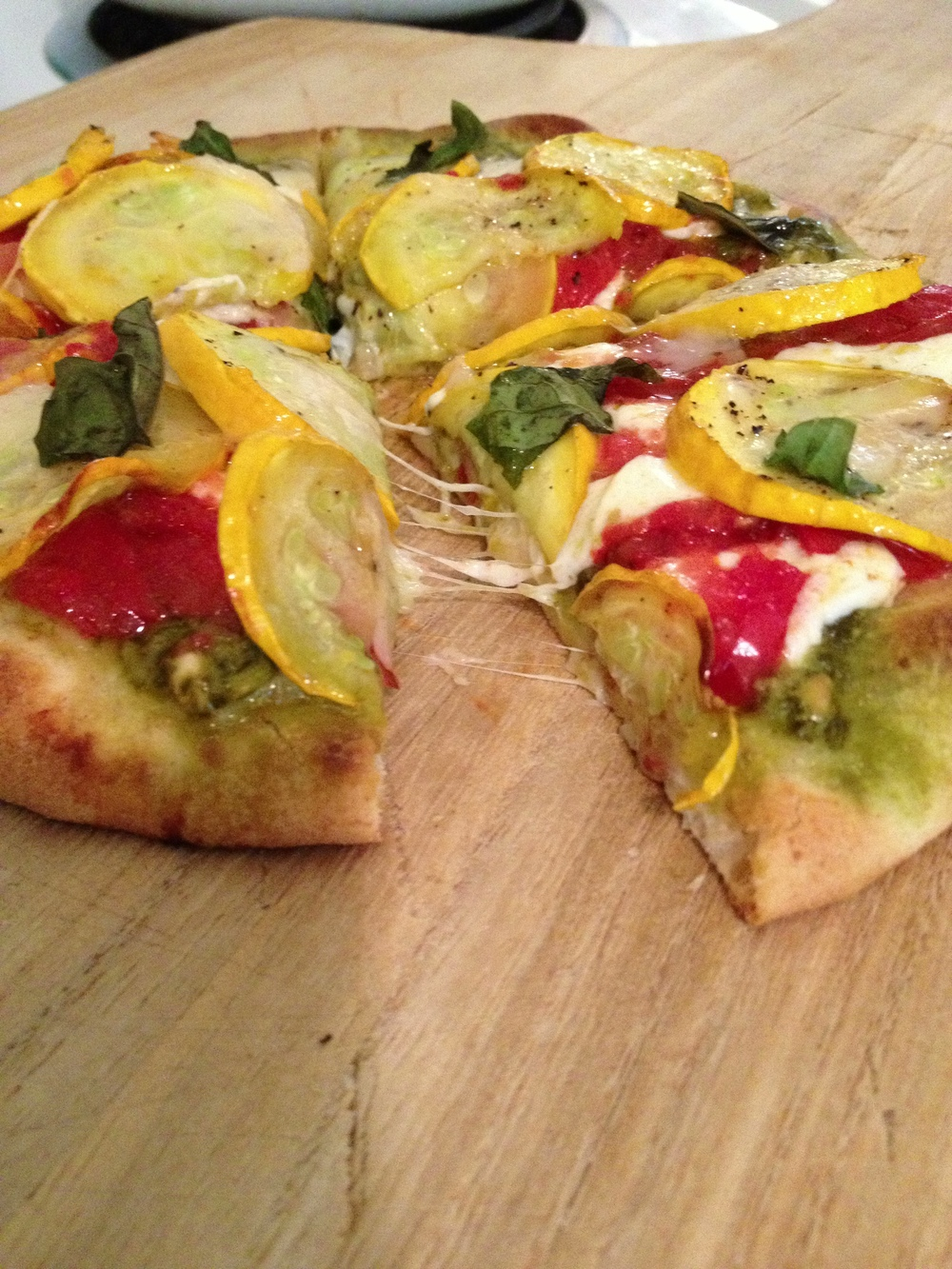 Tomato, onion, & yellow squash pesto pizza