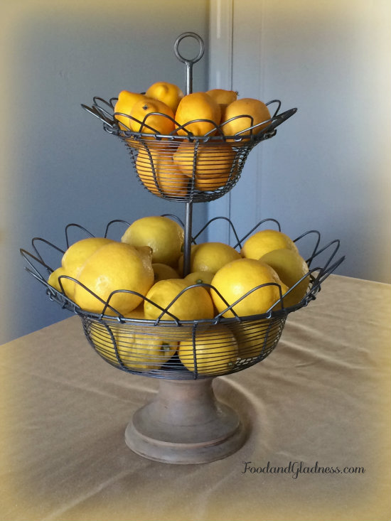 wire basket of lemons food and gladness