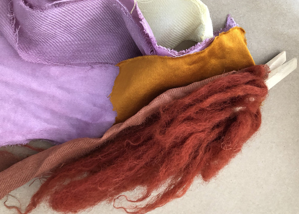 The above bundle is all different natural fibers dyed with hibiscus, eucalyptus, and turmeric.