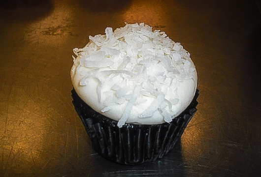 Chocolate Coconut Snowball Chocolate cake with coconut buttercream & shredded coconut.