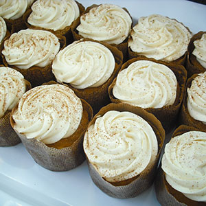 Pumpkin Spice Cupcake   Moist pumpkin cake topped with a spiced cream cheese frosting.