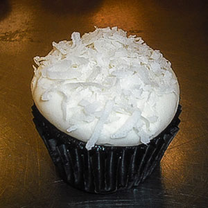 Chocolate Coconut Snowball Cupcake   Chocolate cake with coconut buttercream & shredded coconut.