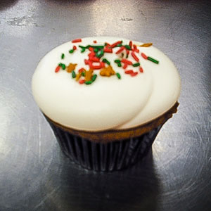 Gingerbread Cupcake   Gingerbread cake with marshmallow fluff cream cheese frosting & sprinkles.