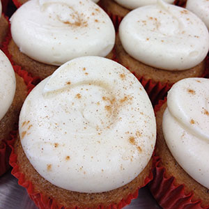 Apple Cider Cupcake   Fluffy apple cider cake topped with cinnamon cream cheese frosting.