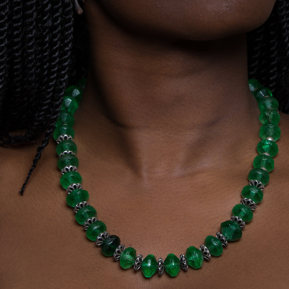 Antique green uranium vaseline glass beads, most likely originally made in Czechoslovakia and used extensively for trading as far south as Africa.    Beads/Necklace:  Arjuna/Toni Zito     Model: Aita     Light: Profoto