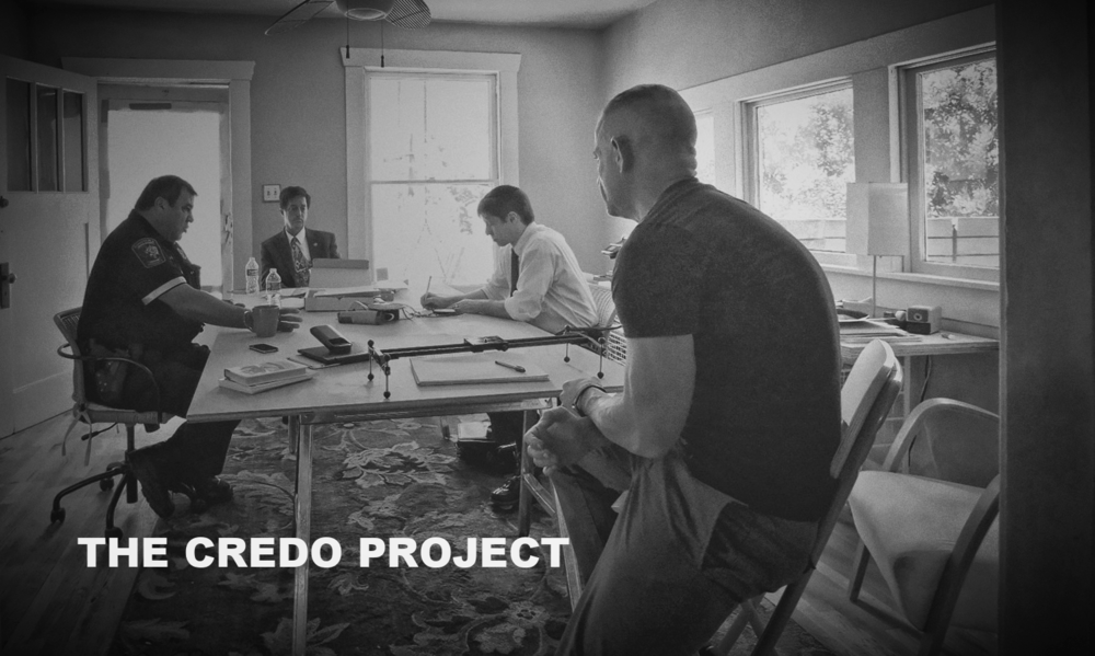 Constable Adan Ballesteros (left) speaks with Rabbi Cary Friedman (right) and Phillip LeConte (foreground) as part of exploratory research for THE CREDO PROJECT.