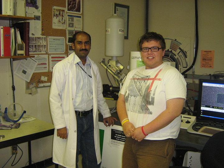 Me and a colleague working on a Field Emission Scanning Electron Microscope (FE-SEM)