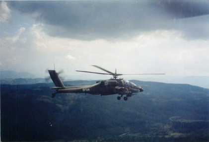 Flying in mission profile in Bosnia. I took this photo from the front seat of my Apache helicopter.