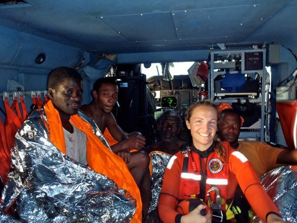 Sara Faulkner with four conch fisherman she helped to rescue. They had been lost at sea for five days.