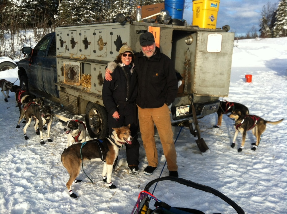 Debbie and her husband Mark with their dogs in Alaska.