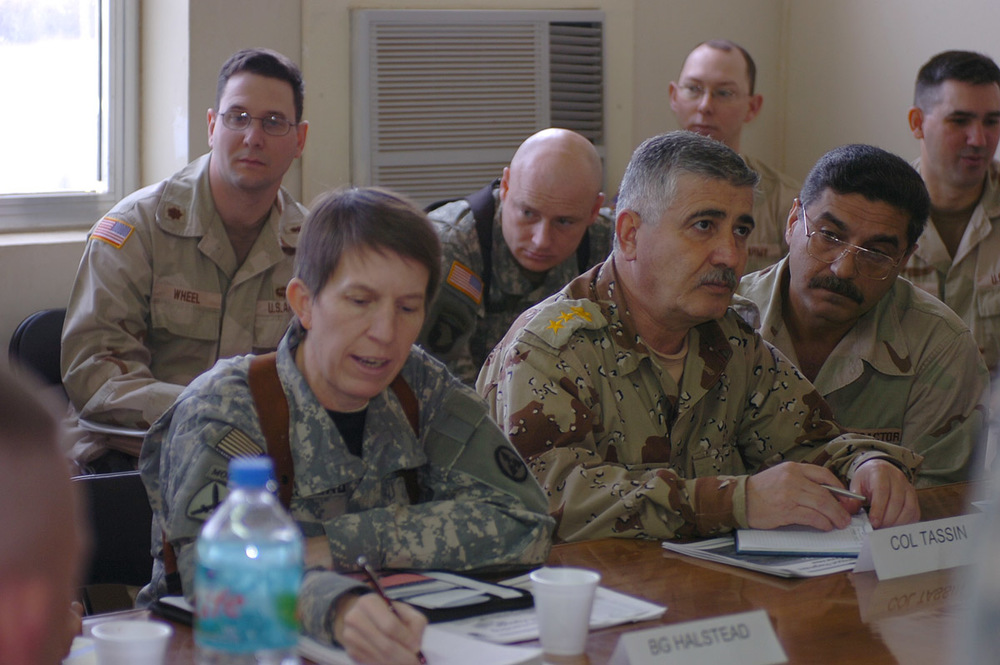 Brigadier General Halstead at a briefing while visiting an Iraqi logistics unit.