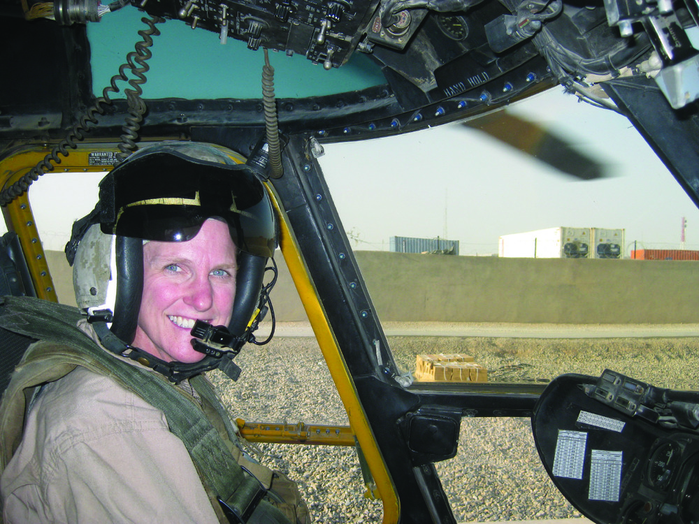 Marine Corps trailblazer, aviator and leader Sarah Deal Burrow in the cockpit of the CH-53E in Lashkar Gah in Afghanistan