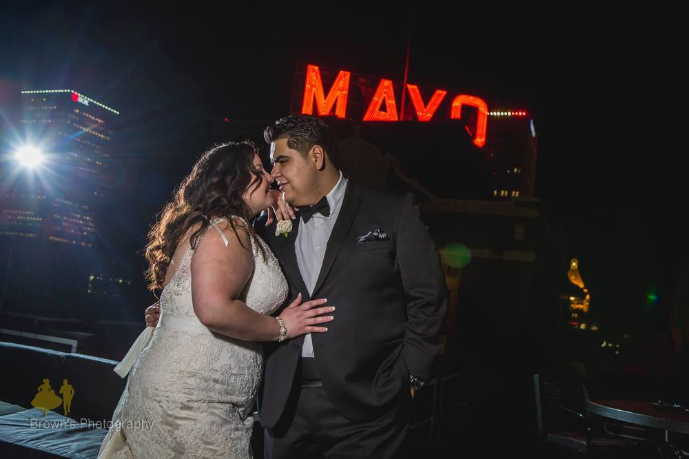 """Our wedding photos were a dream come true.  We could not be happier.  It was so exciting to be featured on The Knot.""  Saul and Michelle.  Tulsa,  Mayo Hotel."