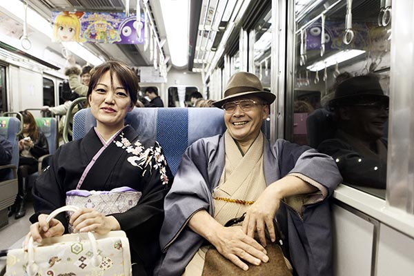 Couple on the Osaka commuter train.