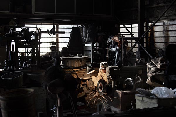 Interior of Kejiro Doi's blacksmith shop, Sakai, Japan