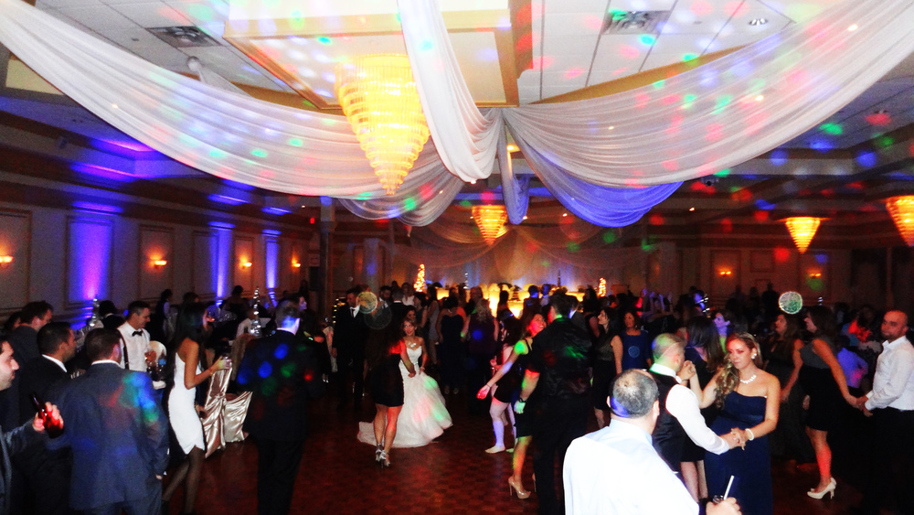 Packed Dance Floor uplighting Del Vinyl Premier Place.jpg