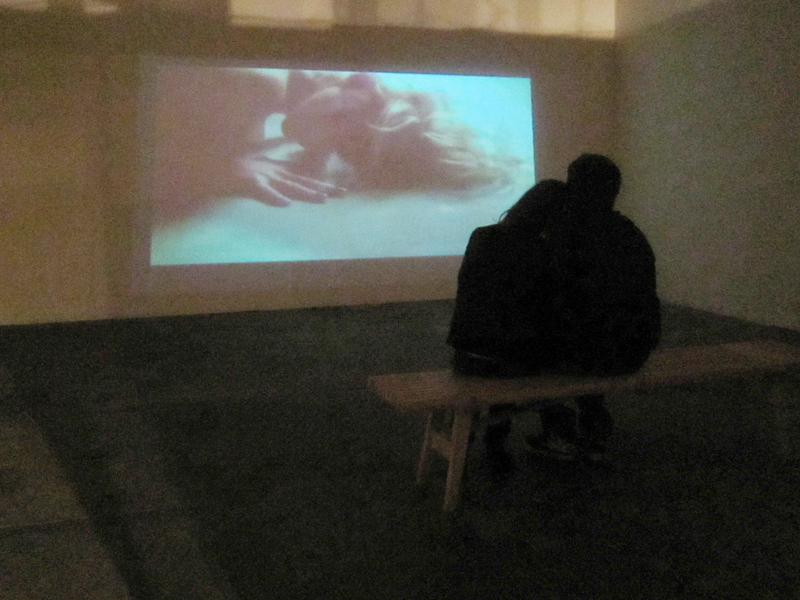 I love this photo I grabbed while my video was running during the OCCA exhibition. It shows the intended response my video was to evoke. Slow down, feel sensual, love someone, love yourself.