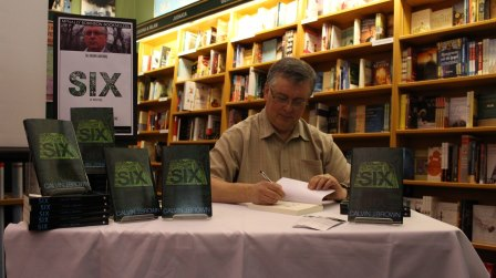 Cal Brown Signs book at a book launch event - self published science fiction author FriesenPress.jpg