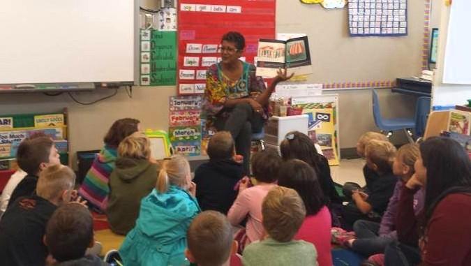 Author Aum Nicolspeaking at a school