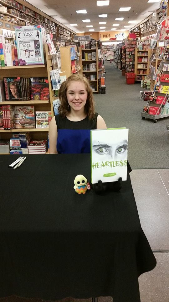 Author Mya Zemlock at a book signing