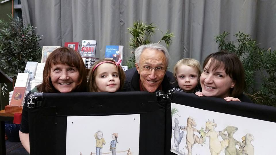 Judy cook (left) and illustrator SONIA nadeau (RIGHT) with friends and family at an event promoting  when dinosaurs go dancing