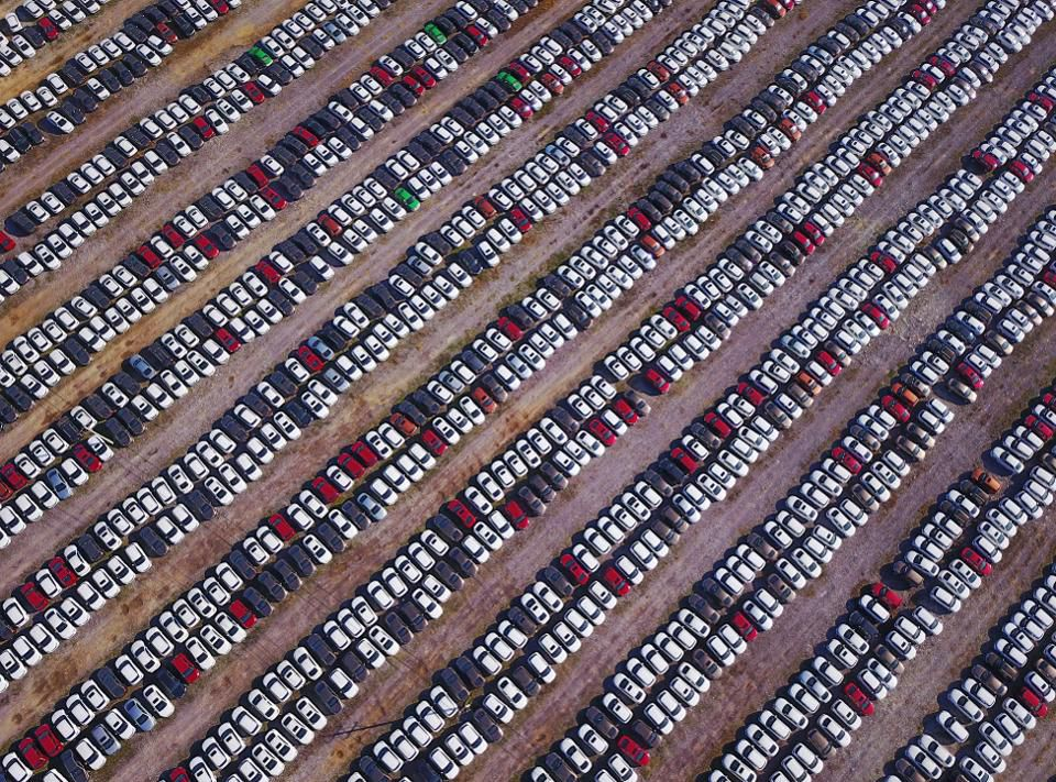 This photo taken on October 14, 2017 shows new cars lined up at a parking lot in Shenyang, northeast China's Liaoning province. (STR/AFP/Getty Images)
