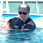 Trigger swims on his own --- look at that smile on his face!