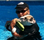 Here I am during my first swim ... do I look scared?  My ears are pinned back, my paw is wrapped around Jean's arm.
