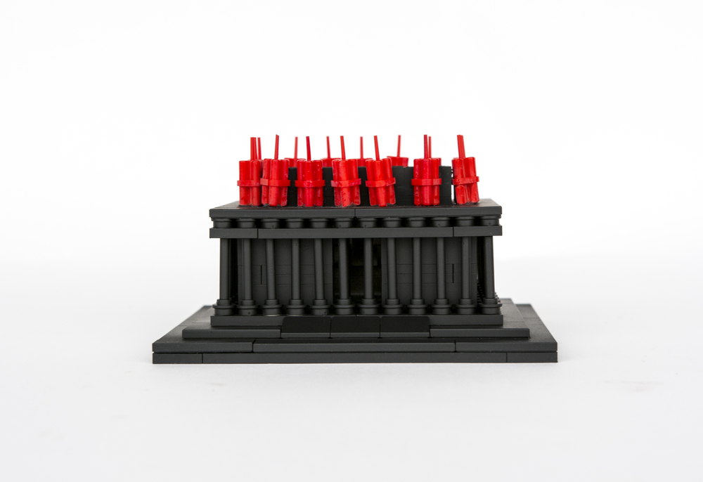 "Anti-Monuments for Counter Histories (09/05/1970) , painted lego pieces and plastic dynamite, 2"" (6cm) tall, 4"" (12cm) wide and 3"" (9cm) deep, 2015"