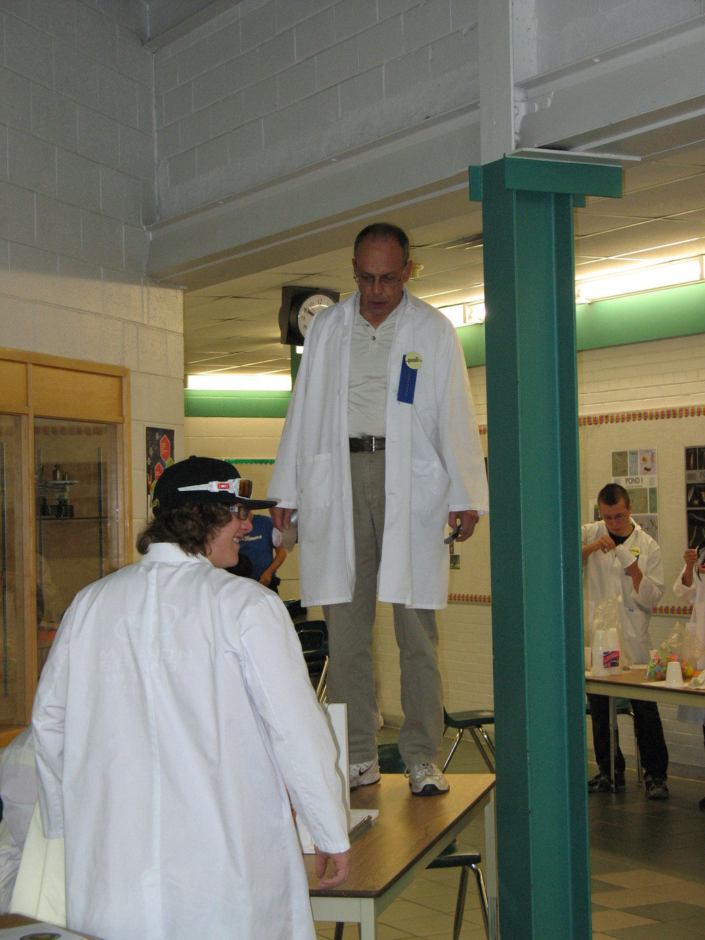 Clem demonstrating an earthquake at the 2011 Family Science Olympics.