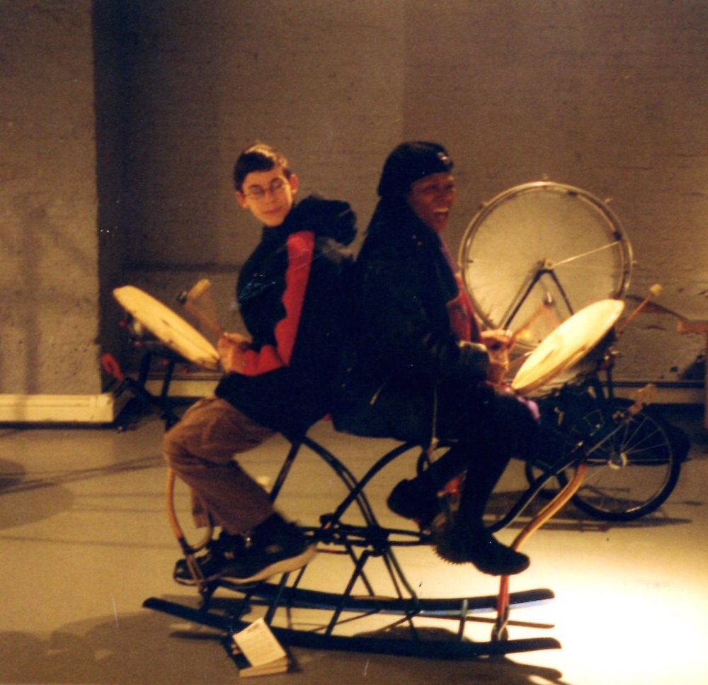 Two members of the public try out one of the musical sculptures included in Helene Brandt's exhibition,  Bicycle Music.  2003