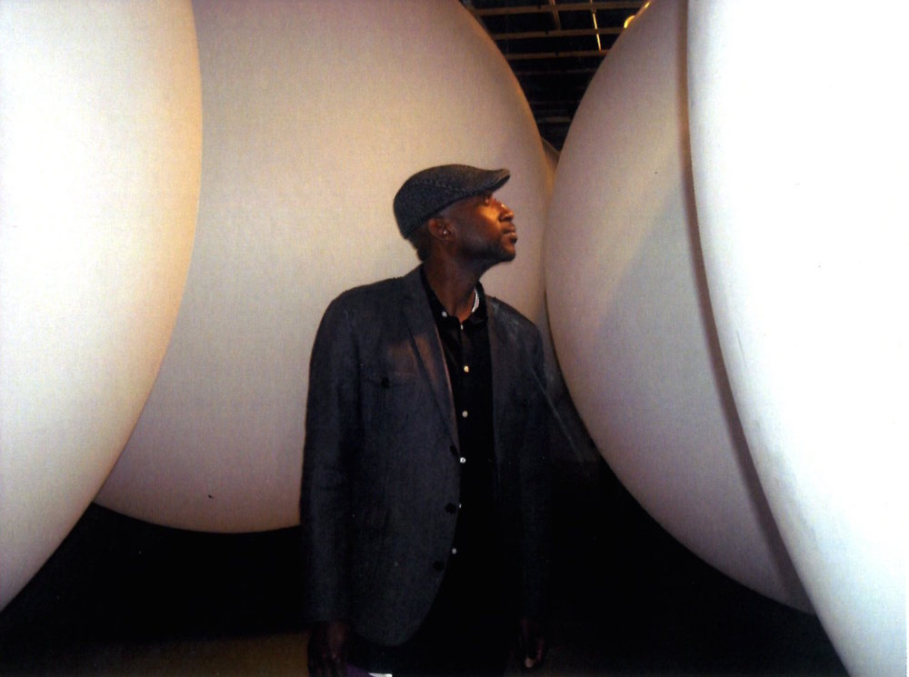 Artist Musa Hixon in his installation of weather balloons,  Time Harvest , 2012