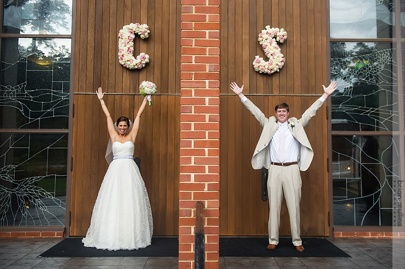 Artfully Arranged created adorable monograms for outside the church doors. Photo by Brian Mullins Photography