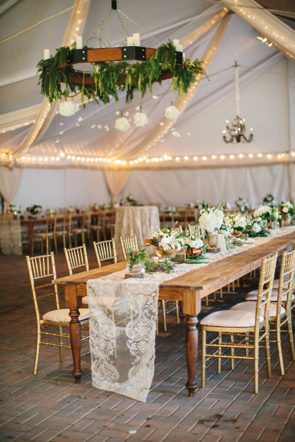 farm table wood and wrought iron chandelier raleigh wedding