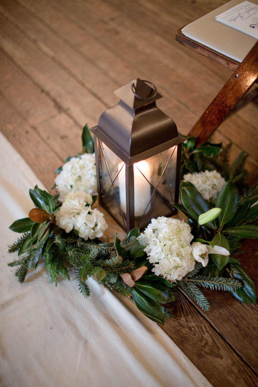 magnolia wreath aisle lantern decor raleigh winter wedding