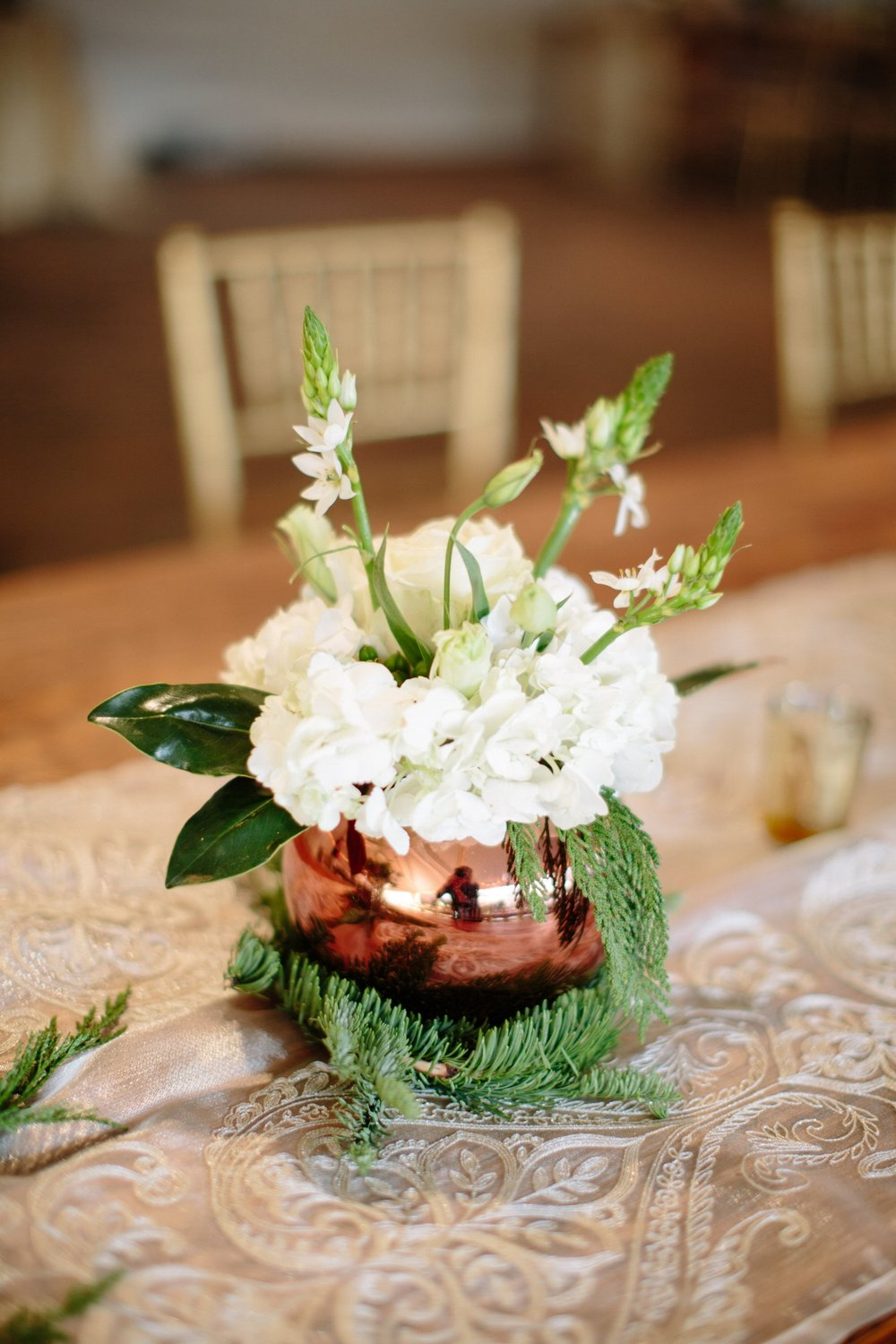 Copper bulb pots filled with winter white florals