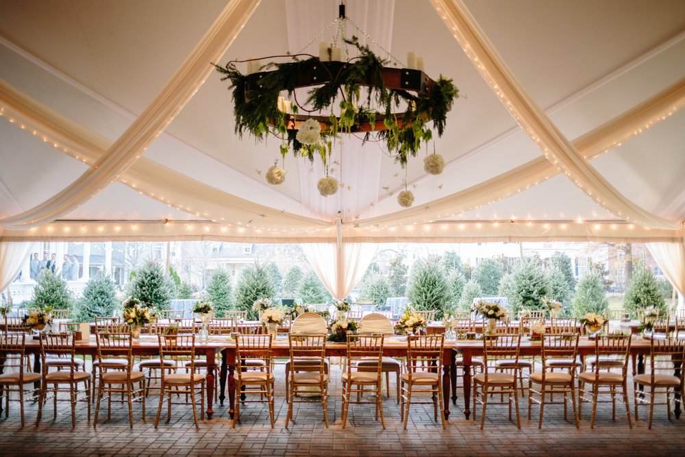 farm table floral chandelier raleigh winter wedding reception