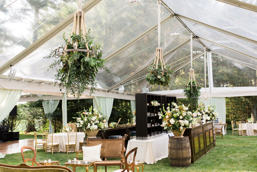 tented at-home wedding reception floral chandelier