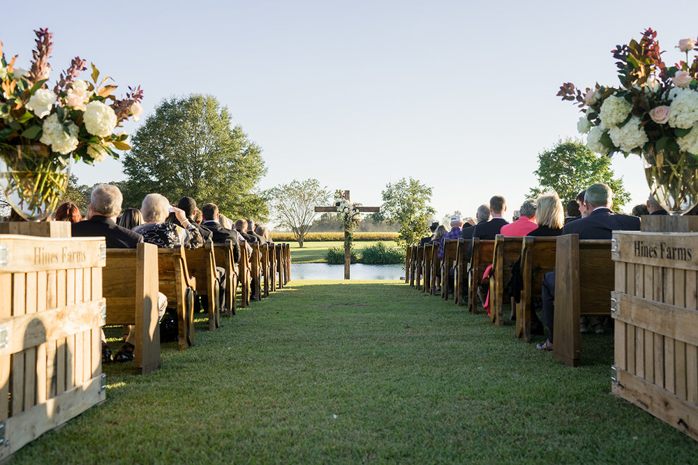 North Carolina tented farm fall wedding ceremony pews