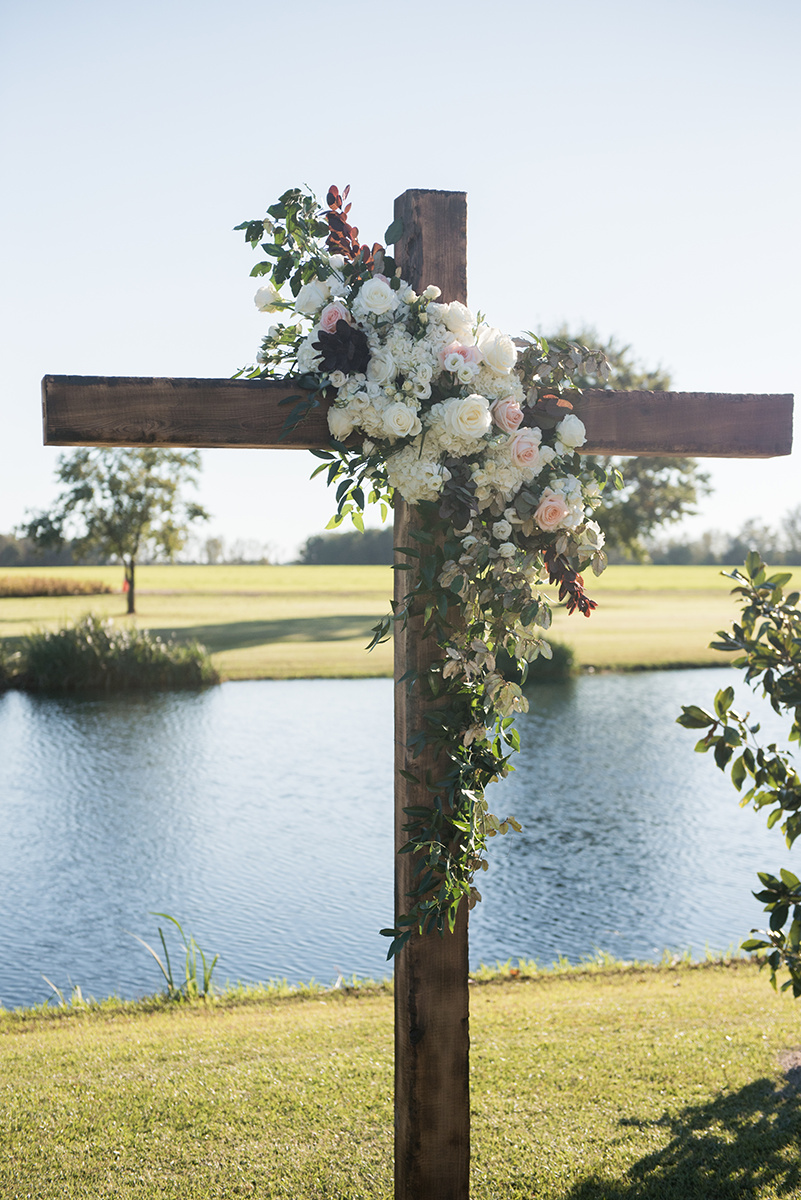 North Carolina tented farm fall wedding cross florals