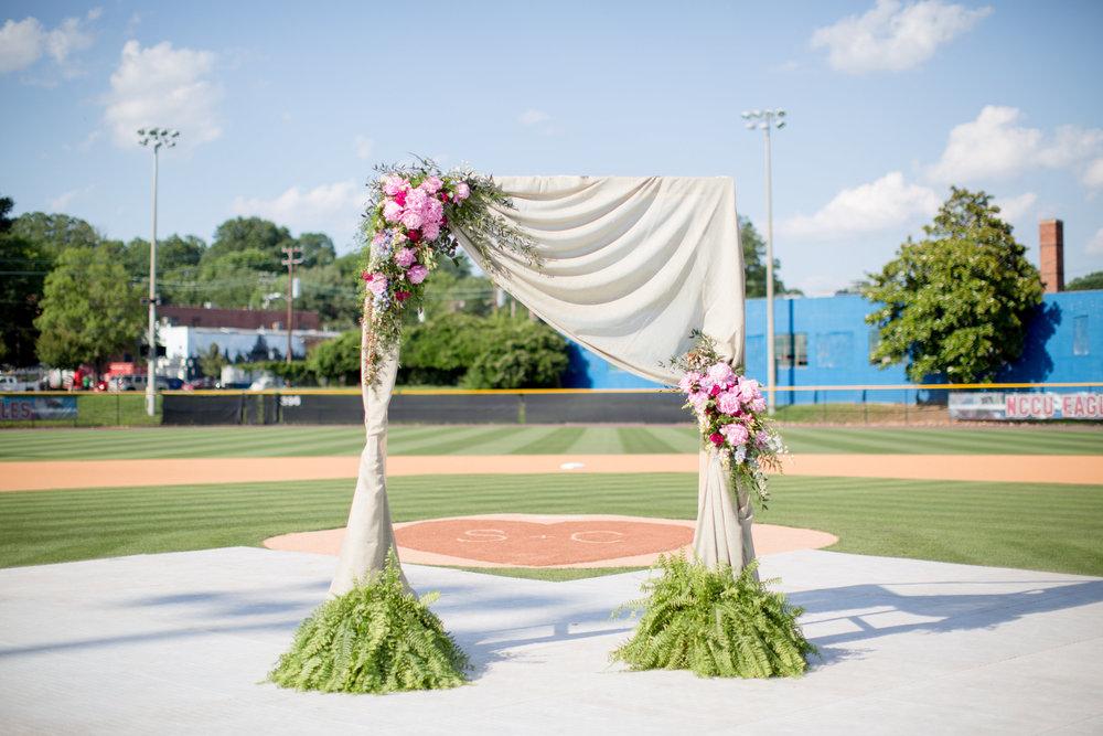 durham athletic park nc wedding floral arbor baseball field